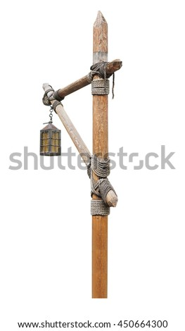 Vintage street lamp on a wooden post. isolated on white background