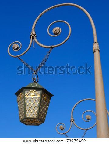 Vintage street lantern on the bridge in Saint-Petersburg, Russia. - stock photo