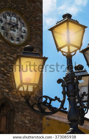 vintage street lights on the background of the fortress wall in Italy