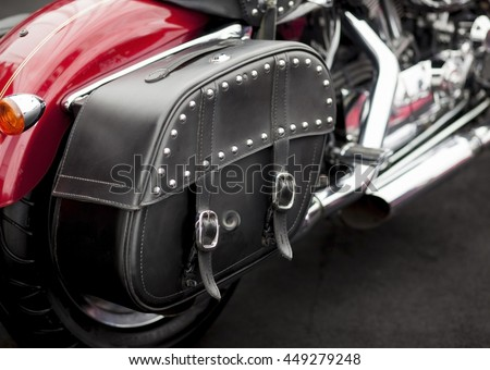 Vintage studded leather bag on a cool red motorcycle.