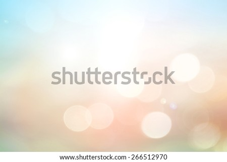 Vintage style. Abstract blurred textured background: pink orange and blue patterns. Blurred nature background. Sandy beach backdrop with turquoise water and bright sun light. Summer holidays concept. - stock photo