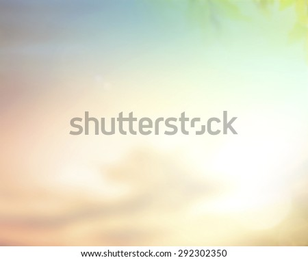Vintage style. Abstract blurred textured background: pink orange and green patterns. Blurred nature background. Sandy beach backdrop with turquoise water and bright sun light. Summer holidays concept. - stock photo