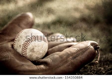 Vintage style baseball glove and ball - stock photo