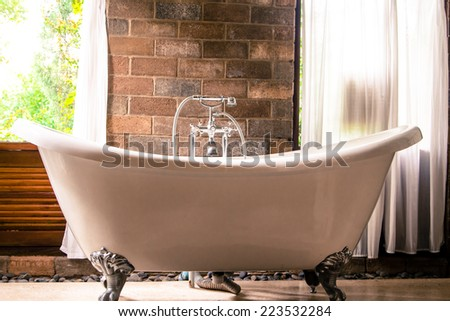 vintage style bathroom and the view from the door. - stock photo