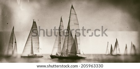 Vintage style black and white image of a sailing regatta on the sea - stock photo