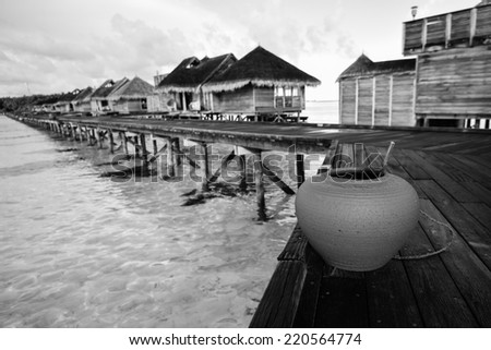 Vintage style black and white image of the beautiful Gili Lankanfushi in the Maldives - stock photo