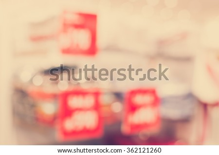 Vintage Style - blurred luxury clothing store in shopping mall - stock photo
