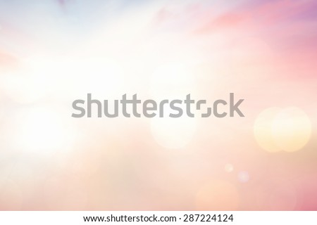 Vintage style. Blurred sunrise over city background with circle light. Abstract blurred nature textured background: pink yellow blue patterns.  - stock photo
