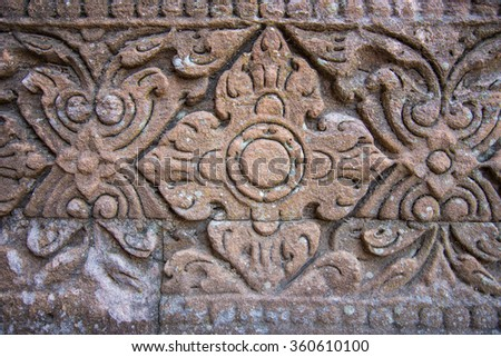 Vintage style carving art on stone brick wall, Close up details background - stock photo