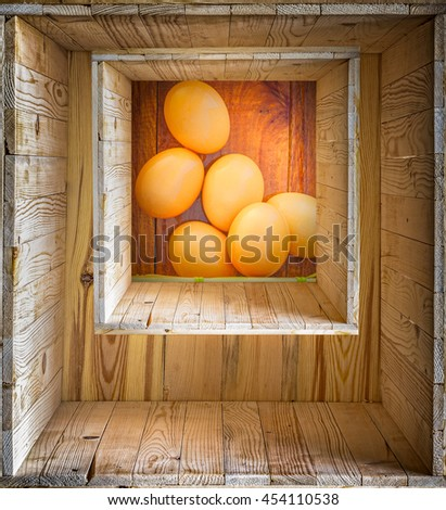 Vintage style Chicken eggs on wooden background Brown Chicken Hen Eggs Basket on Rustic Wood Counter Horizontal.border Design with texture wood  layer background.look old art  From above, Square frame - stock photo