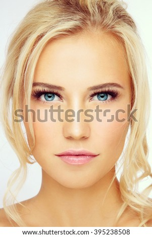 Vintage style close-up portrait of young beautiful blond girl with natural make-up - stock photo