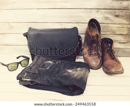 Vintage Style  Clothing Shirts,bags,shoes,sunglasses and jean on wood