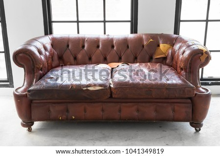 Defective Old Leather Sofa On White Room