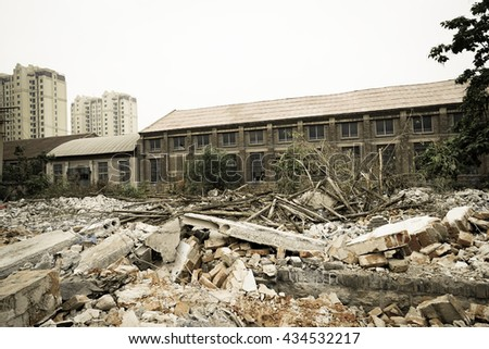 Vintage style - Demolition of buildings in urban environments. House in ruins.
