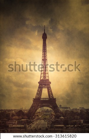 Vintage style Eiffel Tower with vintage grunge texture - stock photo