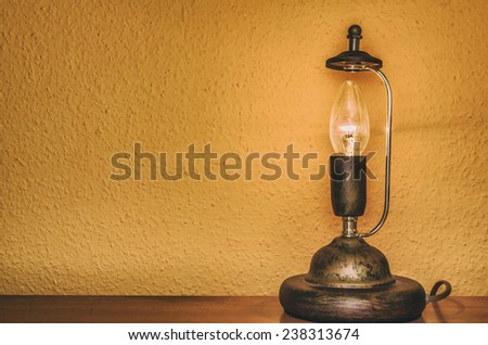 vintage style electric lamp in front of a textured wall