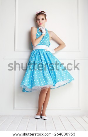 Vintage style fashion portrait of cute smiling blonde teenager girl