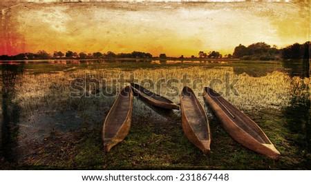 Vintage style image of a sunrise over the Okavango Delta, Botswana - stock photo