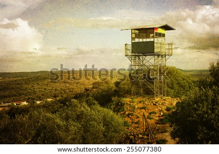 vintage style image of observation tower to prevent fire in the hills - stock photo
