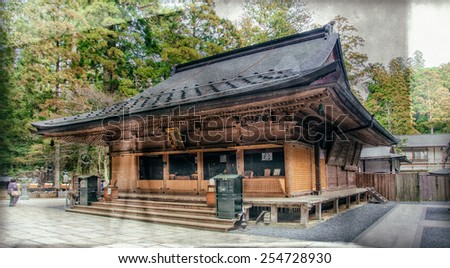 Vintage style image of one of the buildings in the Okunoin Cemetery in Koyasan, Japan. Okunoin is one of the most sacred places in Japan and a popular pilgrimage spot. - stock photo