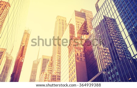Vintage style Manhattan skyscrapers at sunset, NYC, USA. - stock photo