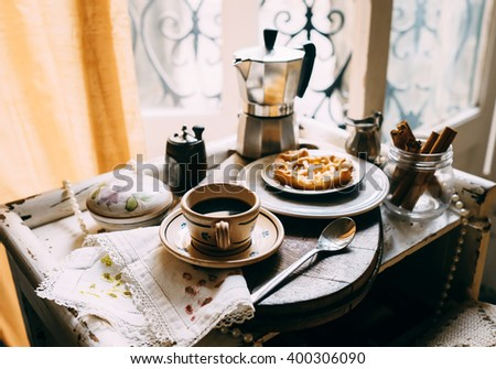Vintage style morning coffee with biscuits - stock photo
