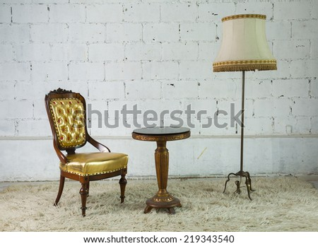vintage style of interior decoration the chair and concrete wall.