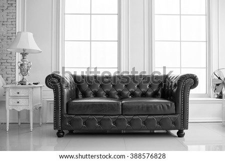 vintage style of interior decoration the leather sofa in white room - stock photo