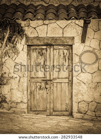 Vintage style old locked colonial doors of mexican hacienda - stock photo