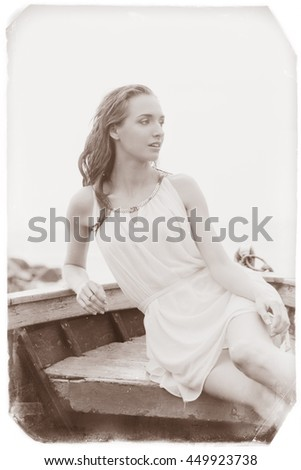 Vintage style photo of a seductive woman sitting in the boat