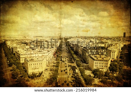 vintage style picture of an aerial view of Paris with the famous Champs-Elysees - stock photo