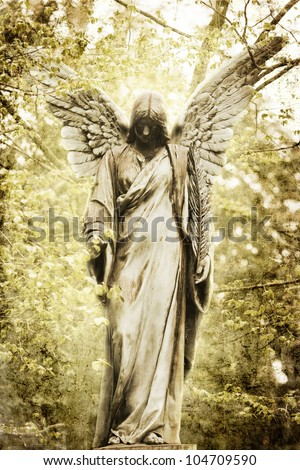 vintage style picture of an ancient angel statue - stock photo