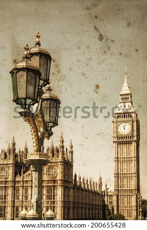 vintage style picture of an old street lamp with the Big Ben and the Westminster Palace in the background  - stock photo
