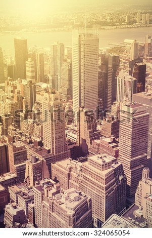 Vintage style picture of Manhattan at sunset, New York, USA. - stock photo