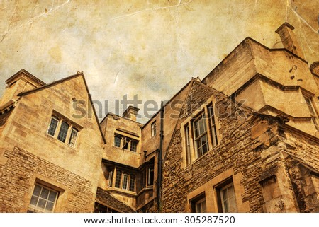 vintage style picture of old houses of an English town - stock photo