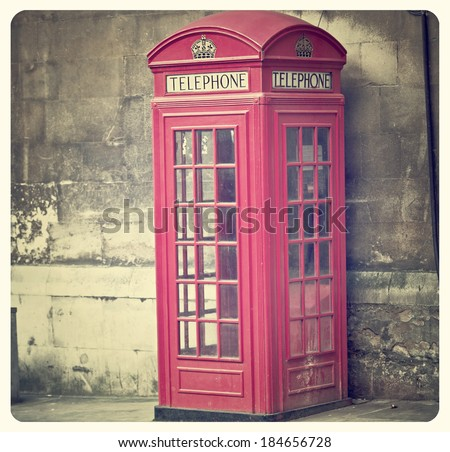 Vintage Style picture of Telephone Box in London with Instagram effect filter - stock photo