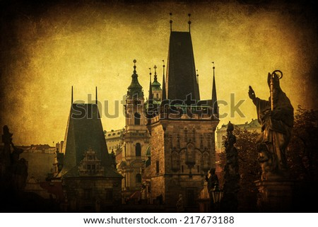 vintage style picture of the Bridge Tower of the famous Charles Bridge on the Lesser Town side in Prague, Czechia - stock photo