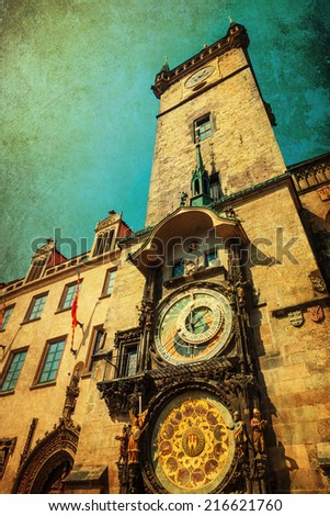 vintage style picture of the tower of the historic town hall with the famous astronomical clock in the old town of Prague, Czechia - stock photo