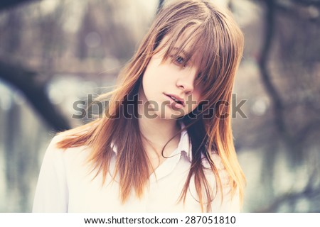 Vintage Style Portrait of Young Beautiful Girl with Windy Hair - stock photo