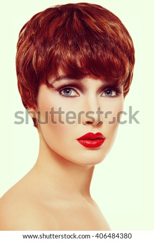 Vintage style portrait of young beautiful redhead woman with short haircut - stock photo