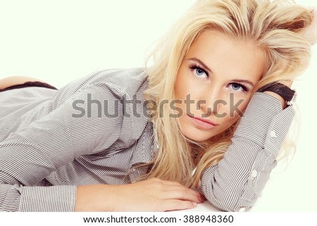 Vintage style portrait of young beautiful sexy blond woman in striped shirt