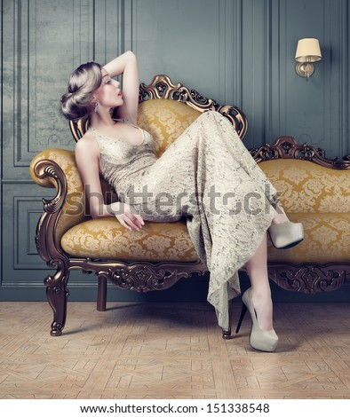 vintage style sensual portrait of beautiful woman in dim light  - stock photo