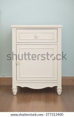 Vintage style short cabinet with drawer in the room - stock photo