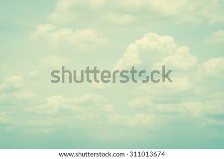 Vintage style sky with soft clouds in cool cyan blue green color tone: Blurred nature background of retro cloudy sky with layers of puffy clouds  - stock photo