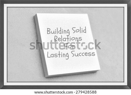Vintage style text building solid relations for lasting success on the short note texture background - stock photo
