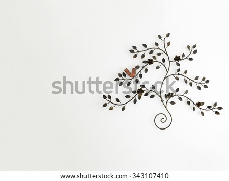 Vintage Style Tree made from Steel in Gold Color with Rose and Bird at the Corner on White Wall Background with Copyspace used as Template - stock photo