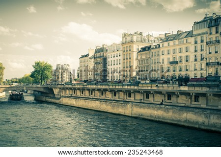 Vintage style view of the River Seine in Paris France - stock photo