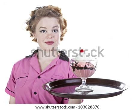 Vintage style waitress or female server serving an ice cream sundae isolated on white. - stock photo