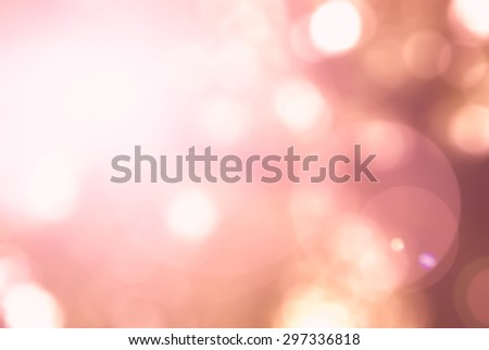 Vintage style warm red orange color tone of blurred nature background of a view looking up through the foliage of a tree against the sky facing sun flare and bokeh   - stock photo