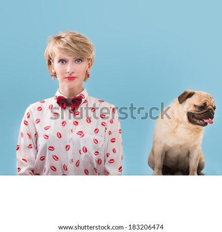 Vintage style woman and her dog sitting by the table, blue background